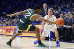 Xavier guard Leighton Schrand (10) passes the ball around Siena guard Jalen Pickett (22) during the first half of an NCAA college basketball game Friday, Nov. 8, 2019, in Cincinnati. (AP Photo/John Minchillo)