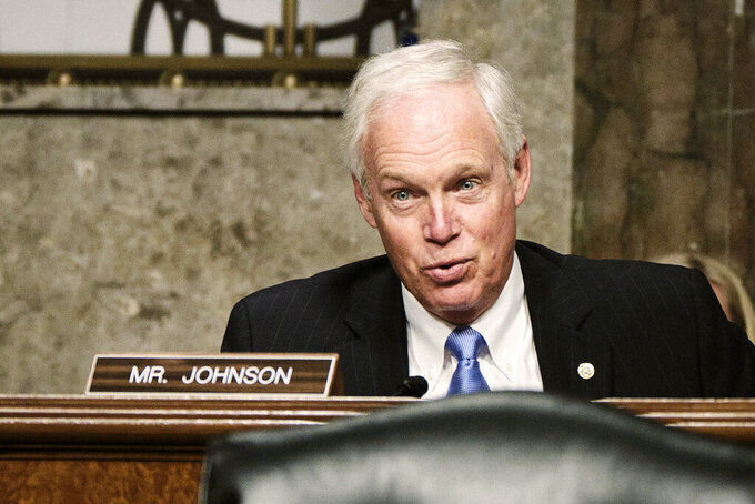 FILE - In this April 27, 2021 file photo, Sen. Ron Johnson, R-Wisc., speaks on Capitol Hill in Washington. Johnson said Thursday, June 3, 2021, he remains undecided about seeking a third term in 2022 and feels no pressure to make up his mind any time soon. (T.J. Kirkpatrick/The New York Times via AP, Pool File)
