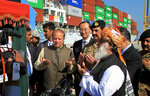 FILE - In this Nov. 13, 2016 file photo, Pakistan's Prime Minister Nawaz Sharif, center left, and Army Chief Gen. Raheel Sharif, fourth right, pray near Chinese Ambassador to Pakistan Sun Weidong, center after inaugurating a new international trade route during a ceremony at the Gwadar port which links to China's western region, west of Karachi, Pakistan. A new study says the massive Chinese infrastructure program called the