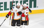 Calgary Flames' Derek Forbort (20) and Sam Bennett (93) celebrate a goal against the Dallas Stars during the second period of a first round NHL Stanley Cup playoff hockey series in Edmonton, Alberta, on Thursday, Aug. 13, 2020. (Jason Franson/The Canadian Press via AP)