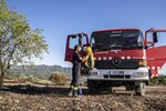 A firefighter stands by a fire truck in La Palma d'Ebre, Spain, Friday June 28, 2019. A major wildfire in northeastern Spain that began in a pile of chicken dung raged out of control for a third straight day Friday with more than 600 firefighters and six water-dropping aircraft battling the blaze in the Catalonia region. Spain is forecast to endure the peak of a recent heat wave, with temperatures expected to exceed 40 degrees Celsius (104 Fahrenheit). (AP Photo/Jordi Borras)