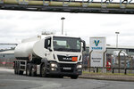 A fuel tanker leaves the Valero Manchester Terminal, in Manchester, England, Tuesday, Sept. 28, 2021. Thousands of British gas stations have run dry, as motorists scrambled to fill up amid a supply disruption due to a shortage of truck drivers. Long lines of vehicles formed at many gas stations over the weekend, and tempers frayed as some drivers waited for hours.  (AP Photo/Jon Super)