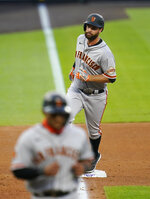 San Francisco Giants' Brandon Belt rounds the bases after hitting a three-run home run against the Colorado Rockies during the fourth inning of a baseball game, Wednesday, Aug. 5, 2020, in Denver. (AP Photo/Jack Dempsey)