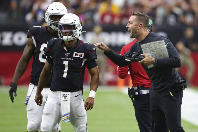 FILE - In this Sunday, Oct. 13, 2019, file photo, Arizona Cardinals head coach Kliff Kingsbury talks with quarterback Kyler Murray (1) during the first half of an NFL football game against the Atlanta Falcons, in Glendale, Ariz. Being a rookie head coach in the NFL is challenging enough, and also calling plays for the offense only increases the difficulty. Murray has helped ease the growing pains for Kingsbury. (AP Photo/Ross D. Franklin, File)
