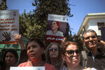 People stage a demonstration outside a court in solidarity with detained journalist Hajar Raissouni, in Rabat, Morocco, Monday, Sept. 9, 2019. Banners in Arabic read