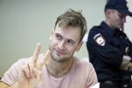 FILE - In this Monday, July 23, 2018 file photo, Pyotr Verzilov, a member of the feminist protest group Pussy Riot, gestures during hearings in a court in Moscow, Russia. Of the four people who protested on the field during the World Cup soccer final in Moscow, one is now in intensive care and another spent part of the week in a jail cell.   On Wednesday, Sept. 12, 2018 five days after speaking to the AP, Verzilov was admitted to the intensive care ward of a Moscow hospital. (AP Photo/Pavel Golovkin, File)