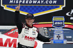 A.J. Allemdinger poses with the trophy after winning the NASCAR Xfinity Cup Series auto race at Michigan International Speedway, Saturday, Aug. 21, 2021, in Brooklyn, Mich. (AP Photo/Carlos Osorio)