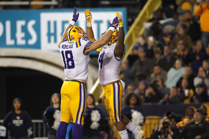 LSU running back Nick Brossette (4) celebrates his touchdown with tight end Foster Moreau (18) in the second half of an NCAA college football game against Rice in Baton Rouge, La., Saturday, Nov. 17, 2018. (AP Photo/Gerald Herbert)