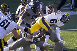 Iowa wide receiver Ihmir Smith-Marsette carries the ball during the first half of an NCAA college football game against Illinois, Saturday, Dec. 5, 2020, in Champaign , Ill. (AP Photo/Charles Rex Arbogast)