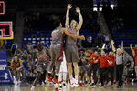 Utah guard Parker Van Dyke, center right, celebrates his winning three-point basket with teammates Sedrick Barefield (2) and Both Gach (11) as time expires during the second half of an NCAA college basketball game against UCLA Saturday, Feb. 9, 2019, in Los Angeles. (AP Photo/Marcio Jose Sanchez)