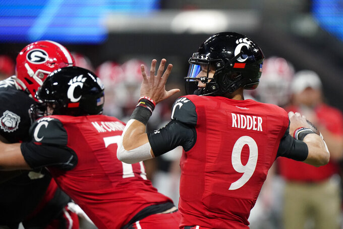 Cincinnati quarterback Desmond Ridder (9) works in the pocket against Georgia during the first half of the Peach Bowl NCAA college football game, Friday, Jan. 1, 2021, in Atlanta. (AP Photo/Brynn Anderson)