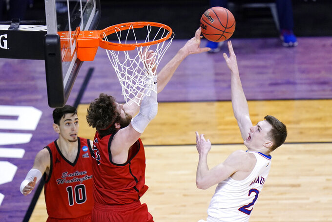 Eastern Washington forward Tanner Groves (35) blocks the shot of Kansas guard Christian Braun (2) during the second half of a first-round game in the NCAA college basketball tournament at Farmers Coliseum in Indianapolis, Saturday, March 20, 2021. (AP Photo/AJ Mast)