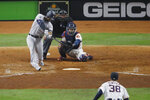 FILE - In this Oct. 13, 2019, file photo, New York Yankees' Aaron Hicks, back left, grounds out during the 10th inning in Game 2 of baseball's American League Championship Series n Houston. Hicks could get his first start since Aug. 3, taking over in center field from Brett Gardner in Game 3 of the AL Championship Series. Gardner would move to left in place of Giancarlo Stanton, who strained his right quadriceps in the opener. (AP Photo/Sue Ogrocki)