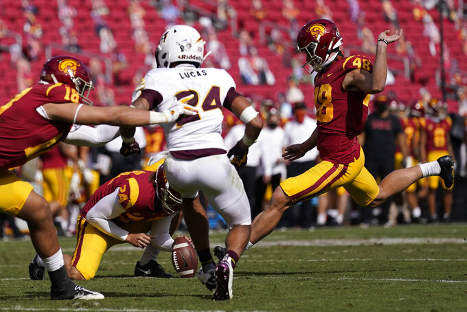 Southern California place kicker Parker Lewis (48) kicks an extra point after an USC touchdown against Arizona State during the second half of an NCAA college football game Saturday, Nov. 7, 2020, in Los Angeles. USC won 28-27. (AP Photo/Ashley Landis)