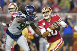FILE - In this Nov. 11, 2019, file photo, Seattle Seahawks defensive end Jadeveon Clowney (90) applies pressure to San Francisco 49ers quarterback Jimmy Garoppolo (10) during an NFL football game in Santa Clara, Calif. Seattle made a couple of additions bringing back Bruce Irvin and Benson Mayowa in free agency. But with continued uncertainty about Clowney, the pass rush must be a priority in the upcoming draft. (AP Photo/Tony Avelar, File)