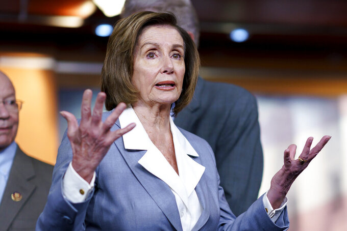 """FILE - In this June 30, 2021 file photo, Speaker of the House Nancy Pelosi, D-Calif., responds to a question at a news conference as the House prepares to vote on the creation of a select committee to investigate the Jan. 6 insurrection, at the Capitol in Washington. Pelosi is rejecting two Republicans tapped by House GOP Leader Kevin McCarthy to sit on a committee investigating the Jan. 6 Capitol insurrection. She cited the """"integrity"""" of the investigation. Pelosi said in a statement Wednesday that she would not accept the appointments of Indiana Rep. Jim Banks, whom McCarthy picked to be the top Republican on the panel, or Ohio Rep. Jim Jordan. Both are close allies of former President Donald Trump.  (AP Photo/J. Scott Applewhite, File)"""