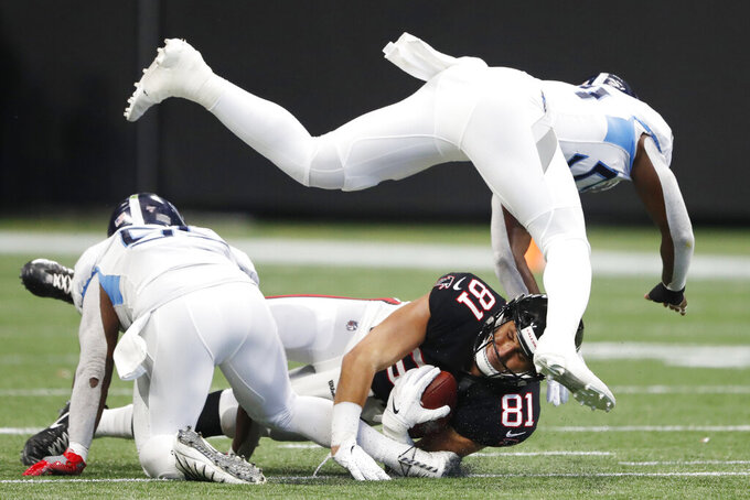 Tennessee Titans inside linebacker Rashaan Evans (54) leaps over Atlanta Falcons tight end Austin Hooper (81) during the first half of an NFL football game, Sunday, Sept. 29, 2019, in Atlanta. (AP Photo/John Bazemore)
