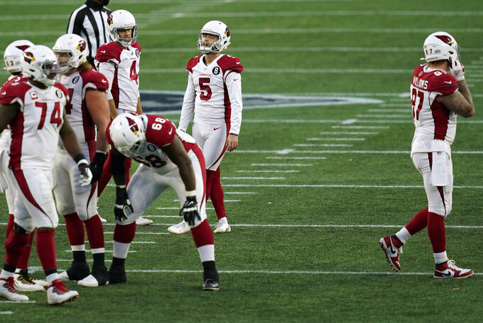 Arizona Cardinals place kicker Zane Gonzalez (5) reacts with teammates after missing a field goal attempt near the end of the second half of an NFL football game against the New England Patriots, Sunday, Nov. 29, 2020, in Foxborough, Mass. (AP Photo/Charles Krupa)