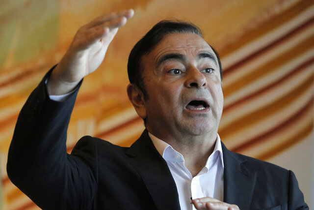 FILE - In this Friday, April 20, 2018, file photo, Nissan Chairman Carlos Ghosn speaks during an interview in Hong Kong. The criminal trial against Japanese automaker Nissan and its former executive Greg Kelly will open in Tokyo District Court on Sept. 15. It's the latest chapter in the unfolding scandal of Carlos Ghosn, a superstar at Nissan Motor Co. until he and Kelly were arrested in late 2018. (AP Photo/Kin Cheung, File)