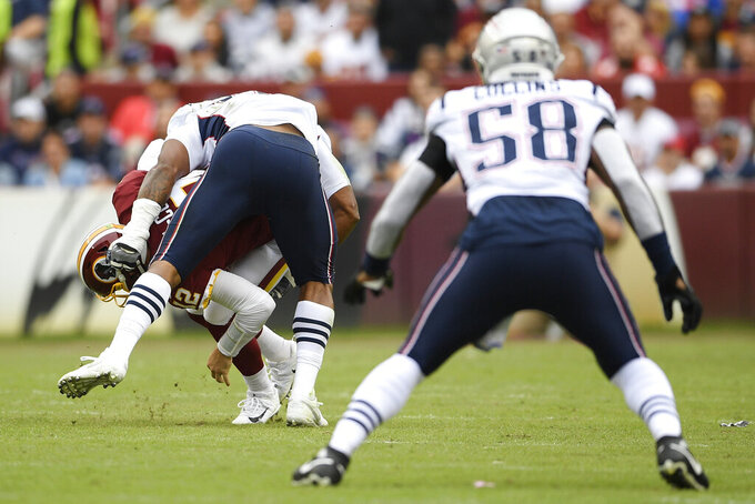 New England Patriots outside linebacker Dont'a Hightower (54) sacks Washington Redskins quarterback Colt McCoy (12) during the first half of an NFL football game, Sunday, Oct. 6, 2019, in Washington. (AP Photo/Nick Wass)