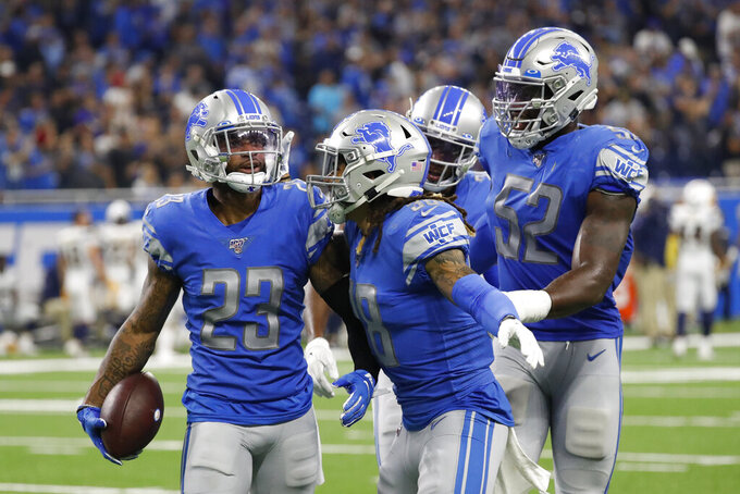 Detroit Lions cornerback Darius Slay (23) celebrates his interception against the Los Angeles Chargers in the fourth quarter of an NFL football game in Detroit, Sunday, Sept. 15, 2019. (AP Photo/Rick Osentoski)