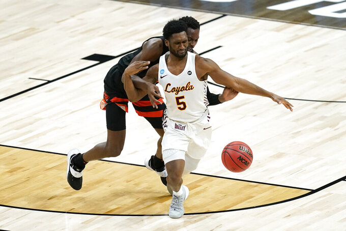 Loyola Chicago guard Keith Clemons (5) chases down a loose ball ahead of Oregon State forward Warith Alatishe during the second half of a Sweet 16 game in the NCAA men's college basketball tournament at Bankers Life Fieldhouse, Saturday, March 27, 2021, in Indianapolis. (AP Photo/Darron Cummings)