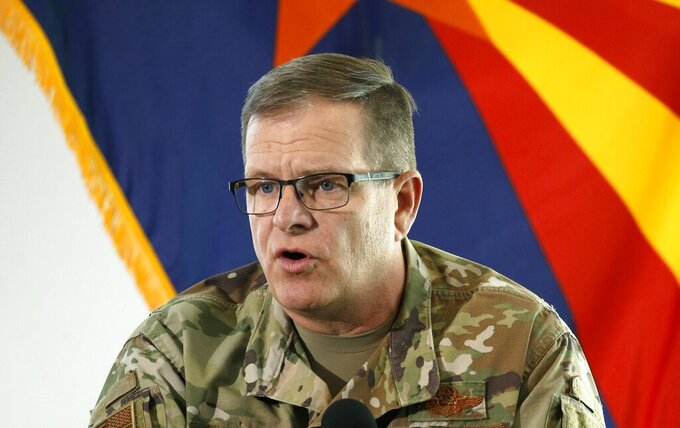 FILE - In this May 20, 2020, file photo, then-Arizona National Guard Maj. Gen. Michael McGuire, director of the Department of Emergency and Military Affairs, answers a question at a news conference in Phoenix. McGuire, the former head of the Arizona National Guard, has filed papers to run for the U.S. Senate, joining what's likely to be a crowded field of candidates seeking the Republican nomination. (AP Photo/Ross D. Franklin, Pool, File)