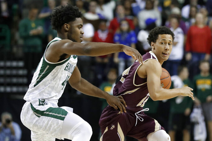 Baylor guard Davion Mitchell (45) defends as Texas State guard Mason Harrell moves the ball around the perimeter during the first half of an NCAA college basketball game in Waco, Texas, Friday, Nov. 15, 2019. (AP Photo/Tony Gutierrez)