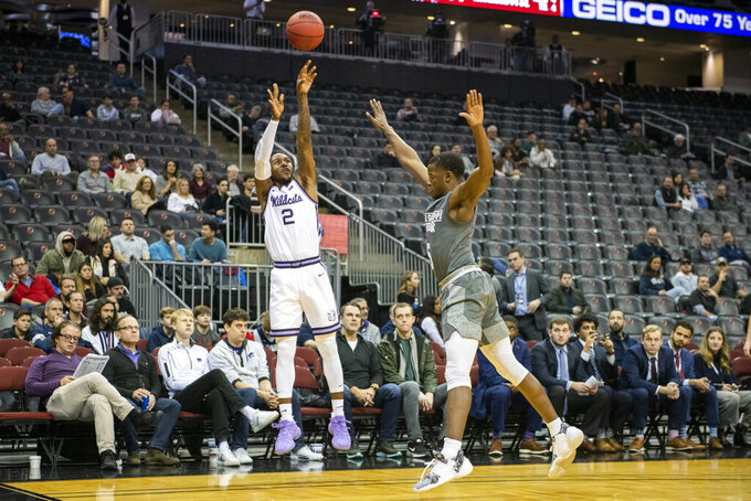 Kansas State guard Cartier Diarra (2) shoots over Mississippi State guard Iverson Molinar (5) during the first half of the Never Forget Tribute Classic NCAA college basketball game, Saturday, Dec. 14, 2019, in Newark, N.J. (AP Photo/Corey Sipkin)