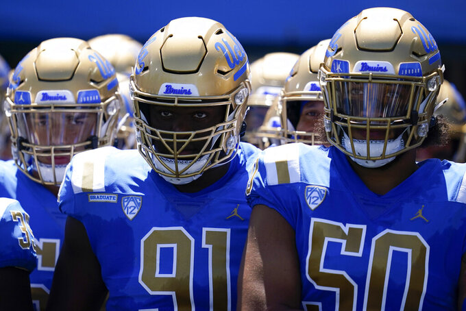 The UCLA Bruins wait to enter the field before an NCAA college football game against the Hawaii Warriors Saturday, Aug. 28, 2021, in Pasadena, Calif. (AP Photo/Ashley Landis)