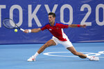 Novak Djokovic, of Serbia, returns to Alejandro Davidovich Fokina, of Spain, during the third round of the men's tennis competition at the 2020 Summer Olympics, Wednesday, July 28, 2021, in Tokyo, Japan. (AP Photo/Patrick Semansky)