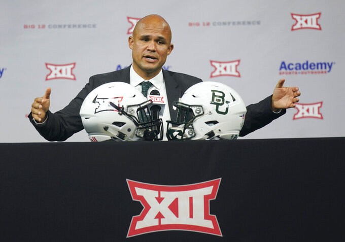 FILE - In this July 15, 2021, file photo, Baylor coach Dave Aranda speaks during the Big 12 football media days in Arlington, Texas. With the NCAA case against the Bears finally resolved, and without any major program-crushing penalties, Aranda and athletic director Mack Rhoades can move forward without that lingering unknown. (AP Photo/LM Otero, File)