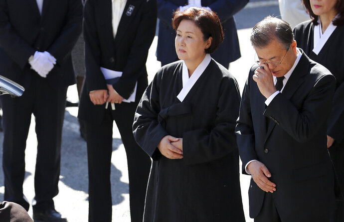 South Korean President Moon Jae-in wipes his tear as his wife Kim Jung-sook stands by after a funeral mass for his mother at Namcheon Catholic Cathedral in Busan, South Korea, Thursday, Oct. 31, 2019. Moon's office says North Korean leader Kim Jong Un has sent a message of condolence to Moon over his mother's recent death.(Son Hyung-joo/Yonhap via AP)