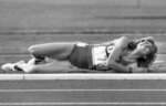 FILE- In this Aug. 11, 1984, file photo, Mary Decker-Slaney grimaces and clutches her leg after a collision with rival Zola Budd during the women's 3,000-meter final at the Summer Olympic Games in Los Angeles. (AP Photo/File)