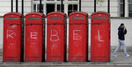 Telephone boxes have 'REBEL' graffiti written across them during a climate protest at Marble Arch in London, Tuesday, April 16, 2019. The group Extinction Rebellion is calling for a week of civil disobedience against what it says is the failure to tackle the causes of climate change. (AP Photo/Kirsty Wigglesworth)
