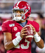 FILE - In this Oct. 19, 2019, file photo, Alabama quarterback Tua Tagovailoa (13) warms up before an NCAA college football game against Tennessee, in Tuscaloosa, Ala. The SEC hasn't had a quarterback picked in the first round of the NFL draft since Johnny Manziel in 2014, and the league has never had more than one quarterback taken in the first round. It appears that's about to change, as Tua Tagovailoa, Joe Burrow and possibly Jake Fromm could make the next draft the best ever for SEC quarterbacks. (AP Photo/Vasha Hunt, File)