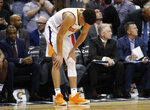 Phoenix Suns guard Devin Booker looks at the floor as time expires during the second half of the team's NBA basketball game against the Boston Celtics, Thursday, Nov. 8, 2018, in Phoenix. The Celtics won 116-109 in overtime. (AP Photo/Matt York)