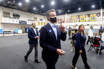 California Gov. Gavin Newsom tours a polling location at the Golden State Warriors training facility on Tuesday, Nov. 3, 2020, in Oakland, Calif. Accompanying him are Oakland Mayor Libby Schaaf and Warriors Chief Operating Officer Rick Welts. (AP Photo/Noah Berger)