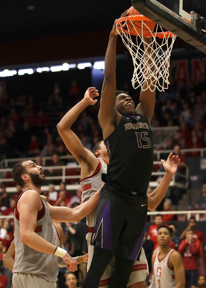 Washington's Noah Dickerson (15) scores against Stanford in the second half of an NCAA college basketball game Sunday, March 3, 2019, in Stanford, Calif. (AP Photo/Ben Margot)