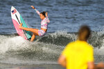 Carissa Moore, from the United States, rides a wave during a training session at the 2020 Summer Olympics, Thursday, July 22, 2021, at Tsurigasaki beach in Ichinomiya, Japan. (AP Photo/Francisco Seco)