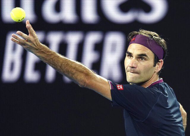 Switzerland's Roger Federer serves to United States' Steve Johnson during their first round singles match at the Australian Open tennis championship in Melbourne, Australia, Monday, Jan. 20, 2020. (AP Photo/Lee Jin-man)