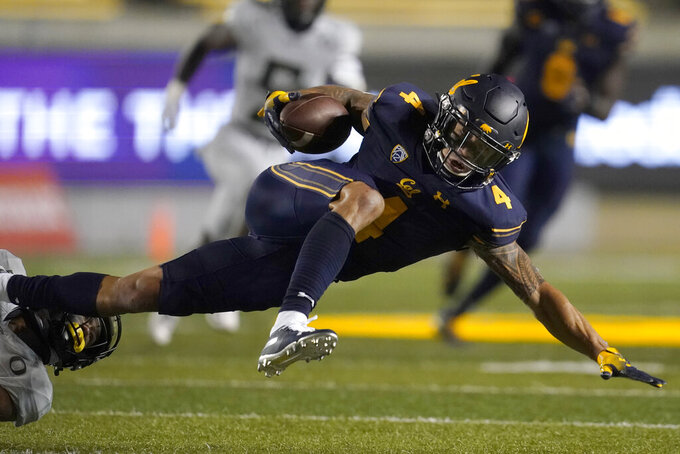 California's Nikko Remigio is tackled on a punt return during the second half of the team's NCAA college football game against Oregon in Berkeley, Calif., Saturday, Dec. 5, 2020. (AP Photo/Jeff Chiu)