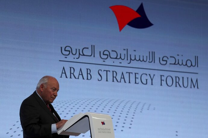 Former U.S. Vice President Dick Cheney talks to the audience at the Arab Strategy Forum in Dubai, United Arab Emirates, Monday, Dec. 9, 2019. Cheney warned Monday that