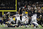 Los Angeles Rams kicker Greg Zuerlein kicks the game-winning field goal in overtime of the NFL football NFC championship game against the New Orleans Saints, Sunday, Jan. 20, 2019, in New Orleans. The Rams won 26-23. (AP Photo/Carolyn Kaster)