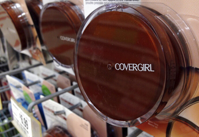 FILE- In this July 9, 2015, file photo a Covergirl makeup product hangs on a display at a store in Haverhill, Mass. German conglomerate JAB Holdings is seeking a majority stake in Coty Inc., which makes CoverGirl, Max Factor and Hugo Boss brand cosmetics and fragrances. JAB is offering to buy up existing stock from shareholders at $11.65 per share, marking a 20 percent premium from its closing on Monday, Feb. 11, 2019. (AP Photo/Elise Amendola, File)