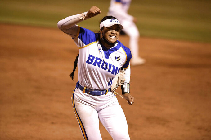 Starting pitcher Megan Faraimo of UCLA Bruins reacts after getting the final out of the game in the seventh inning to defeat Virginia Tech 2-0 on a one hitter to win game two of the NCAA Softball Super Regional Game on Easton Field on the campus of UCLA in Westwood on Friday, May 28, 2021. (Keith Birmingham/The Orange County Register via AP)