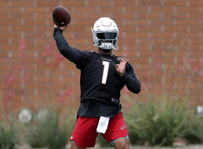 Arizona Cardinals' quarterback Kyler Murray works out during an NFL football rookies camp, Friday, May 10, 2019, at the team's' training facility in Tempe, Ariz. (AP Photo/Matt York)