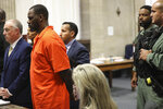 R. Kelly standing beside his attorney, Steven Greenberg as Kelly appears for a hearing at the Leighton Criminal Court building, Tuesday, Sept. 17, 2019 in Chicago. (Antonio Perez/ via AP, Pool)