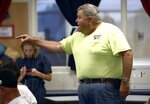 In this Aug. 22, 2019 photo, parent Dennis Hoffman expresses his displeasure at a meeting at Highland High School in Marengo, Ohio, about how the school board handled a recent incident where a child had access to a gun, pointed it at another student, and that parents weren't informed. Schools across the country have faced a backlash for favoring privacy over telling parents when there are threats in their children's classrooms. Safety experts advise schools to tell parents as much as they can as soon as they can about threats. (Fred Squillante/The Columbus Dispatch via AP)