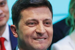 FILE - In this Sunday, April 21, 2019 file photo, Ukrainian comedian and presidential candidate Volodymyr Zelenskiy smiles after the second round of presidential elections in Kiev, Ukraine. Volodymyr Zelenskiy, who takes the presidential oath on Monday, comes into the post having never held political office; his popularity is rooted in playing the role of president on a television sit-com. (AP Photo/Vadim Ghirda, File)